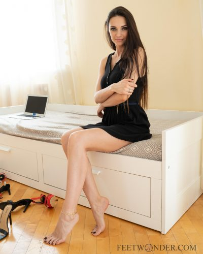 Girl shows her feet and legs