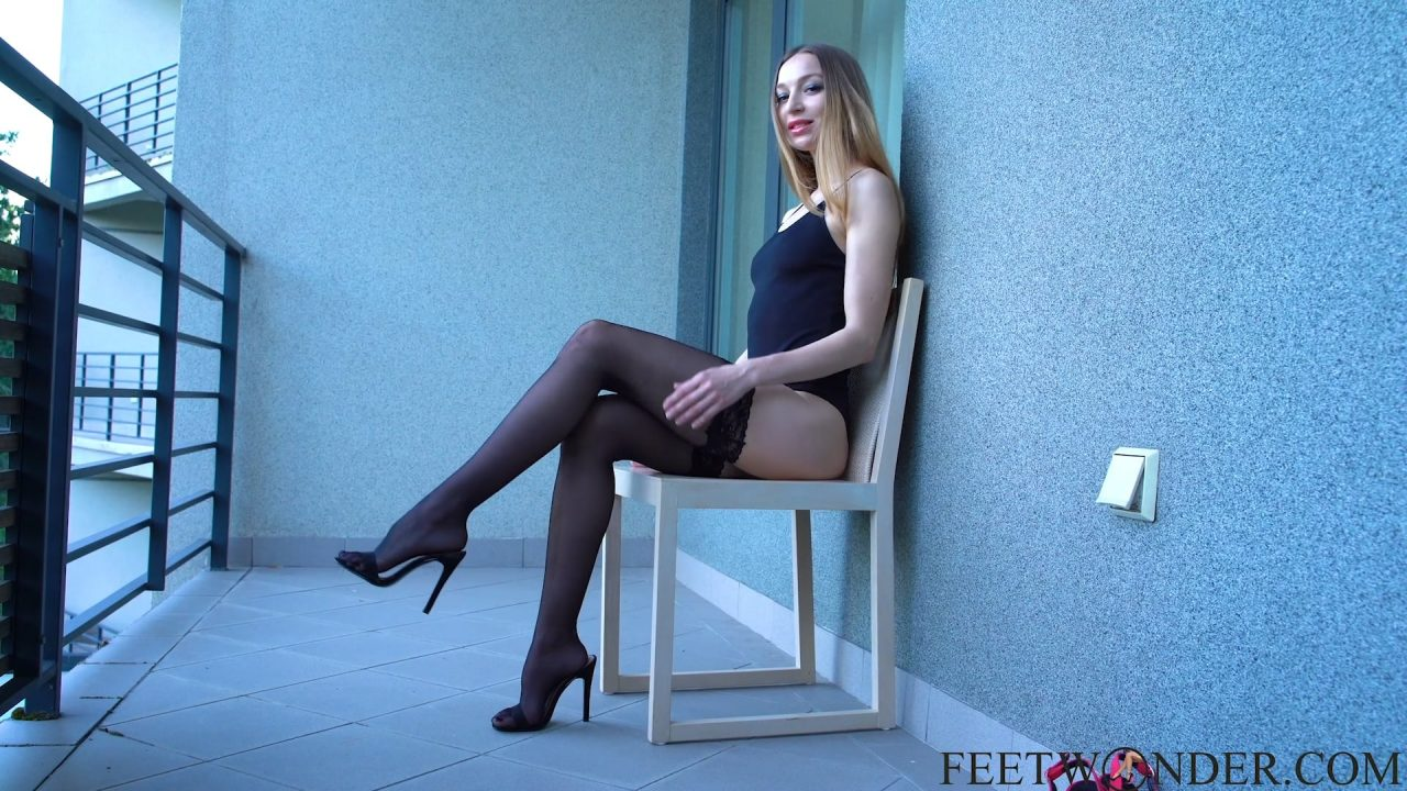 Long Legs In Black Stockings