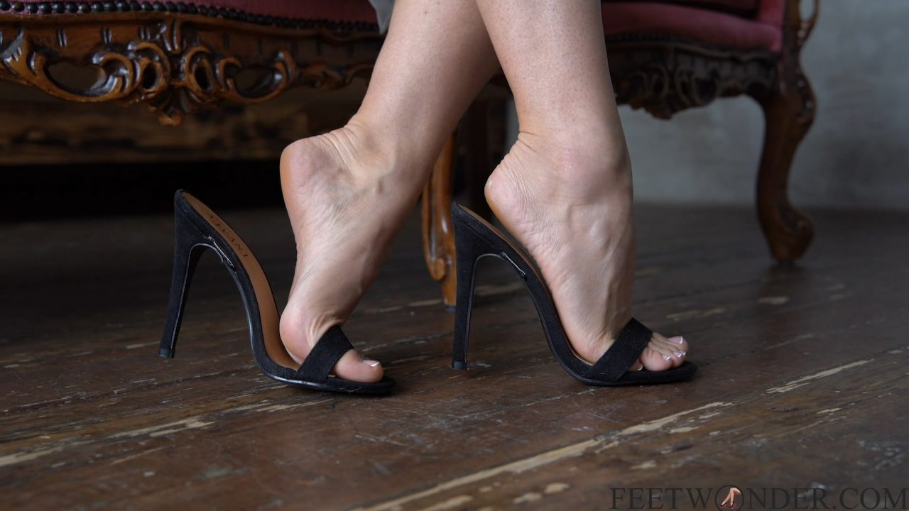 black high heels dangling