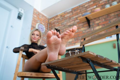 Blond Girl Shows Her Feet And Soles