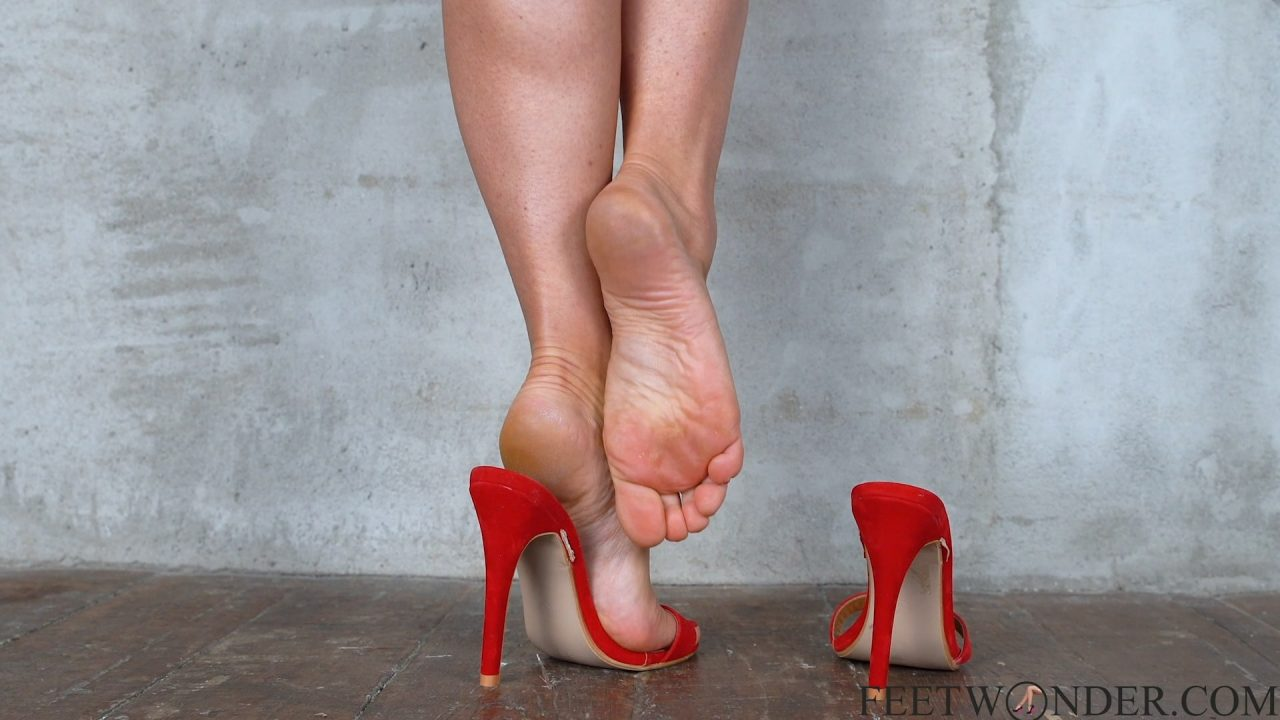 Female Feet And Soles With Red Toes