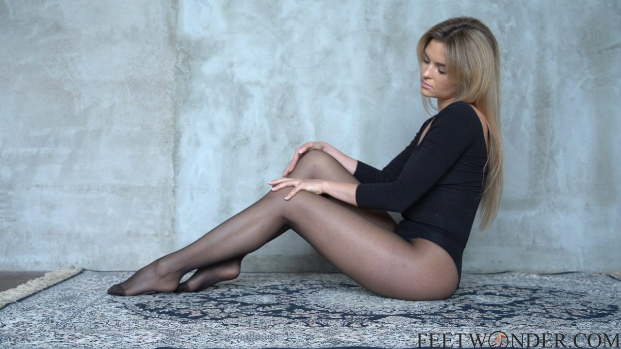 Sexy Tease In Black Pantyhose