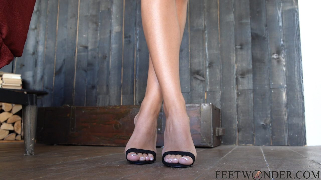 crossed feet with french pedicure