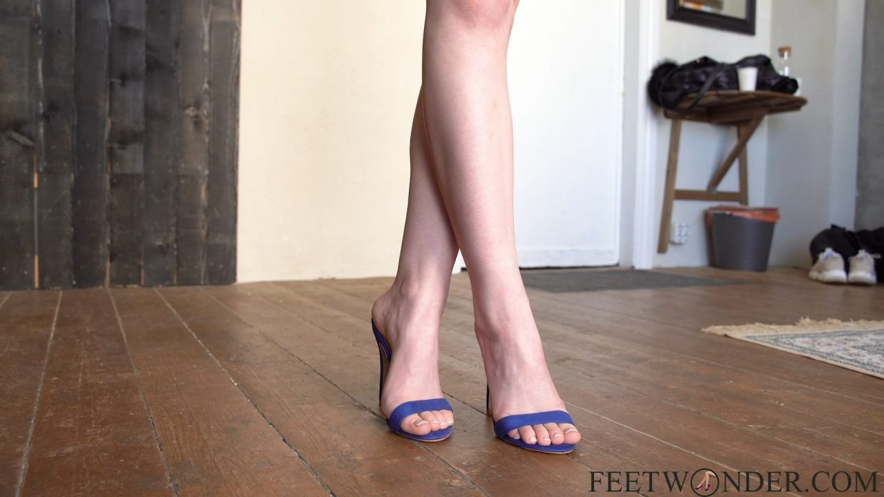 crossed female feet in high heels