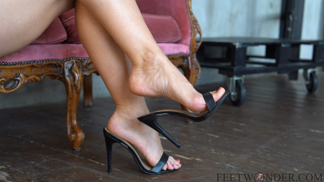 mature feet dangling and leg crossing