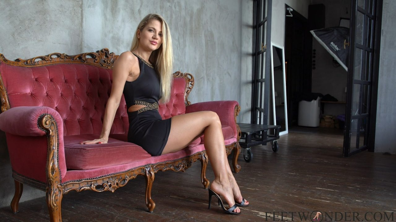 mature woman shows her legs and feet