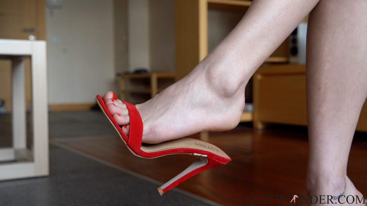 feet dangling red mules