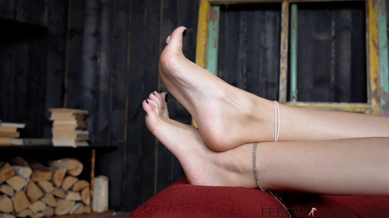 barefoot girl shows her toes