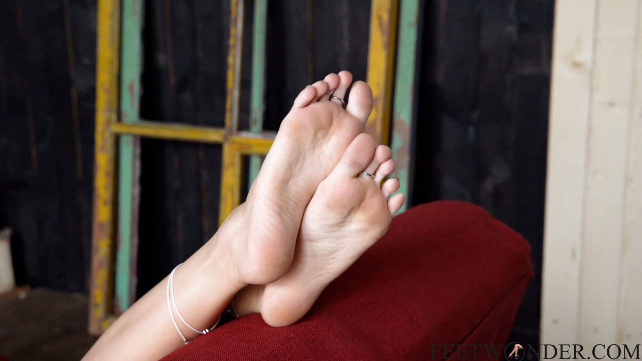 pretty blong girl shows her soles