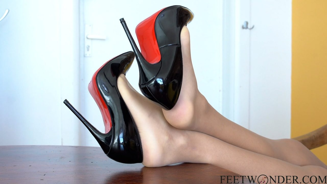 feet in high heels and nylon pantyhose