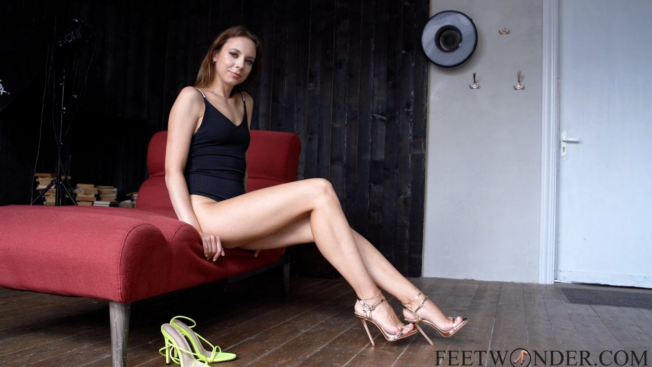 Girl With The Long Legs Shows Her Feet