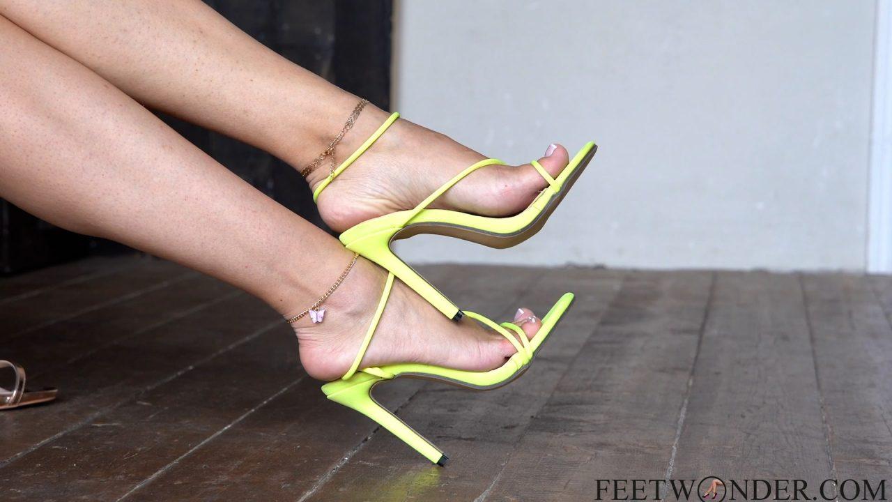 feet in high heeled sandals