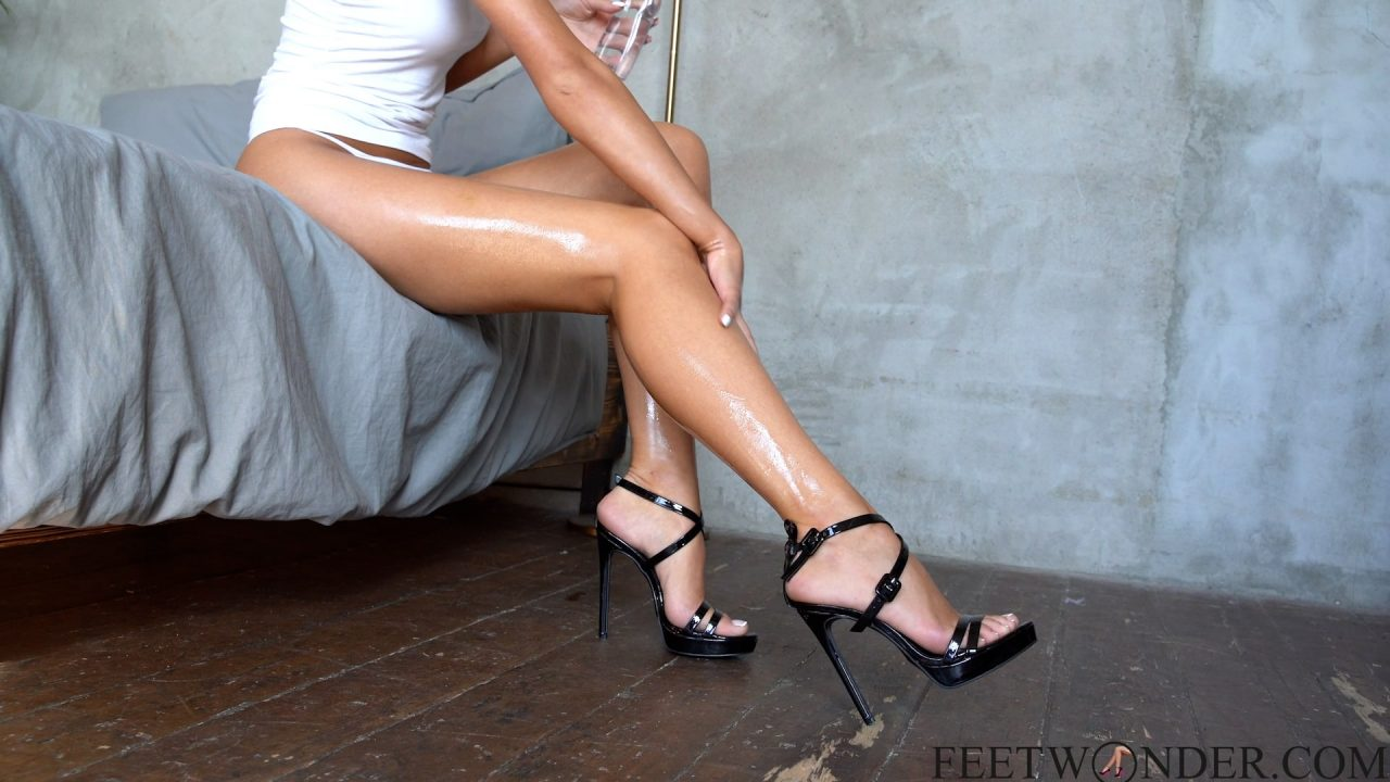 Oiled Legs And Feet In High Heels
