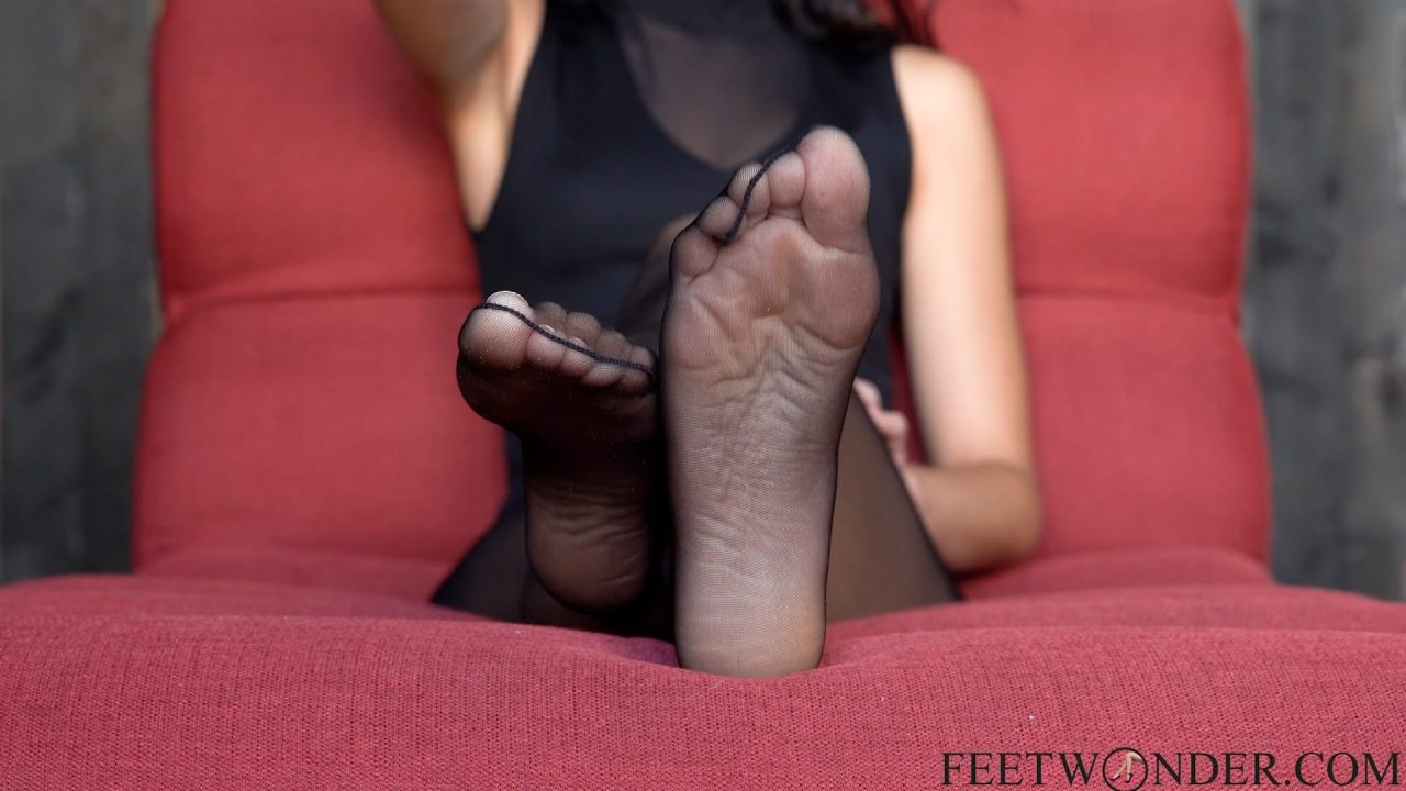female feet in black pantyhose