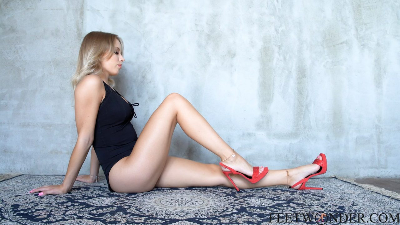 Barefoot Blond Girl Plays With Her Feet In High Heels